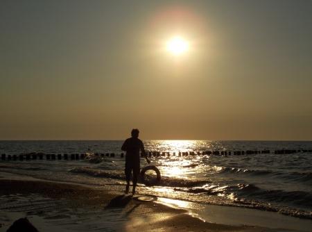 lifebouy: man with rescue wheel on sea background