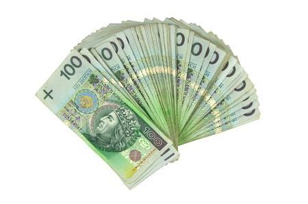 a lot of polish money isolated on white background photo