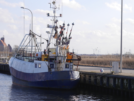 blue fishing boat in harbour photo