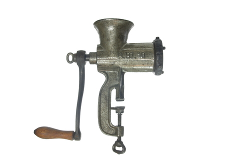 old metal meat mincer on white background  photo
