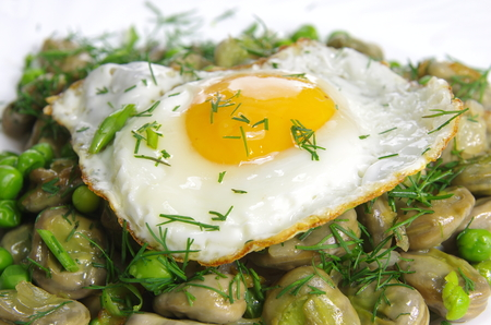 boiled broad bean with fried egg and dill Stock Photo