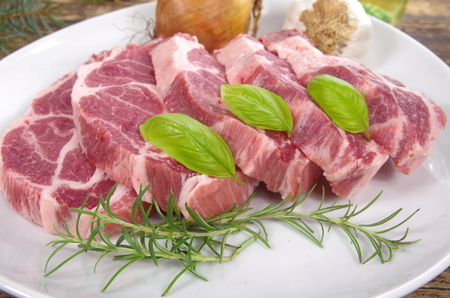 neck with rosemary and basil on white plate photo