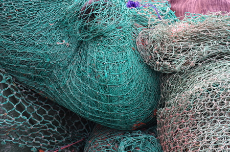 fishing net: blue fishing net with knots Stock Photo
