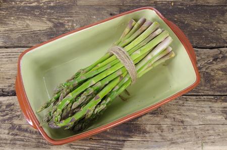 bundle: bundle of green asparagus  in bowl