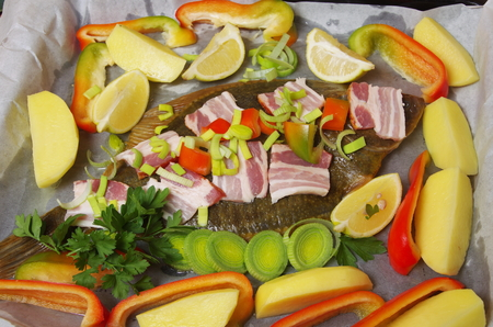 plaice: raw fish flounder with vegetable and bacon