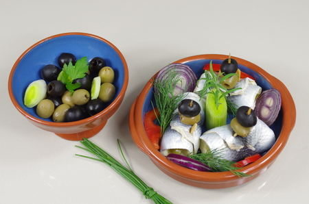 appetizing: appetizing rollmop with onion and dill