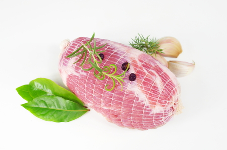 raw ham: raw ham with rosemary and laurel on  plate