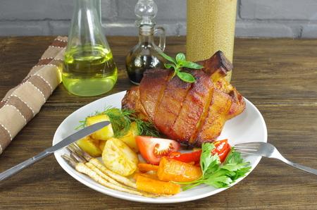 appetizing baked knuckles of pork on plate