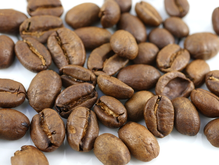 theine: roasted coffee on white background