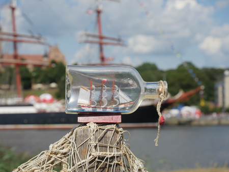 sailcloth ship in closed with cork bottle on harbor background Stock Photo