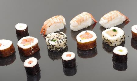 portion sushi on black plate Stock Photo