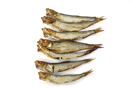 smoked whole sprats on white background Stock Photo
