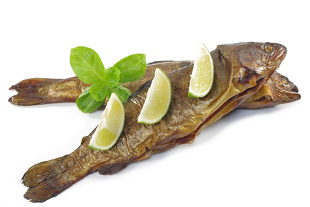 smoked trout with basil and lemon on white background