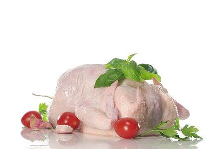 raw chicken with parsley on black plate Banque d'images