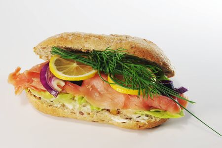 sandwich with smoked salmon on white background
