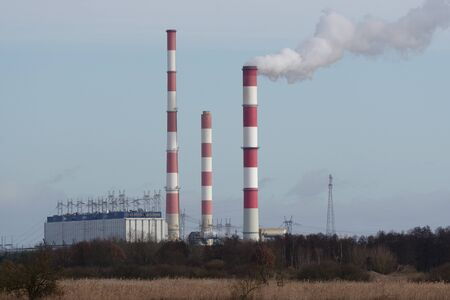 power station with chimney and cable on sky background Banque d'images