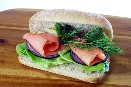 sandwich with smoked salmon on board background