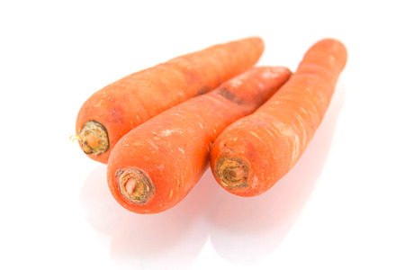 Rotten carrot isolated on white background Stock Photo
