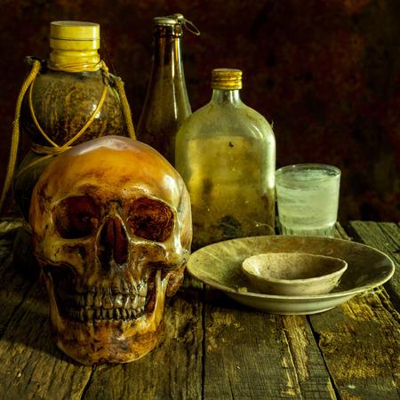 cadaver: Still Life with a Skull on wooden