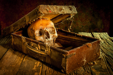 Still life with a human skull with old treasure chest and gold, diamond and jewelry Stock Photo