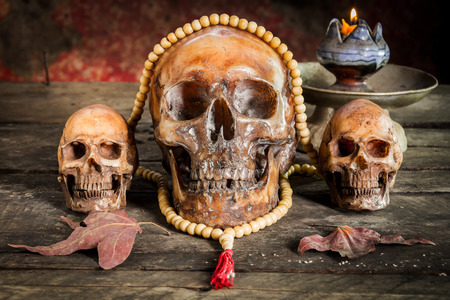 Skull rosary on the old wooden floor.