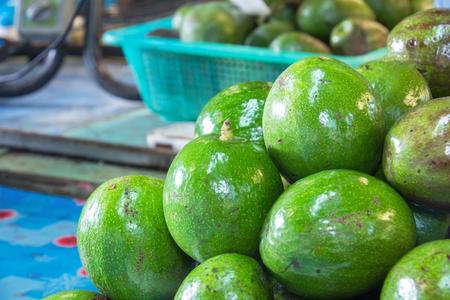 Avocado background. Fresh green avocado on a market Stock Photo