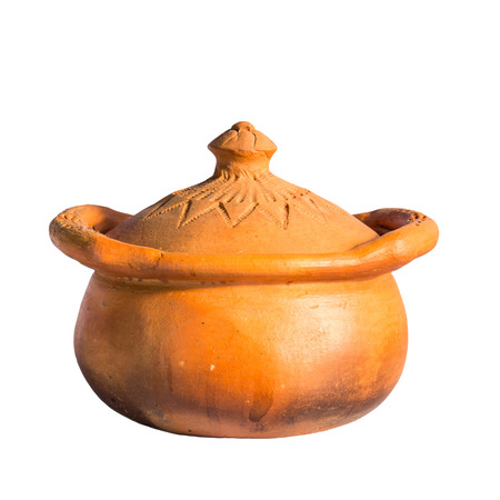 Clay pots are used for cooking isolated from a white background. Stock Photo