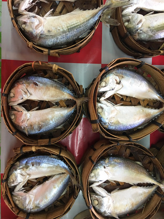 Mackerel fish in bamboo basket at market, Thailand