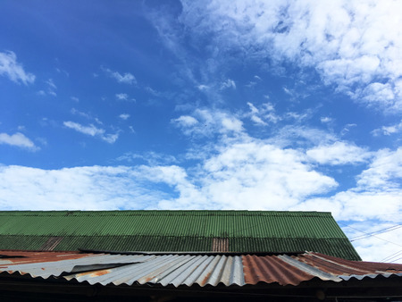 Old roof overlooking the sky on the background
