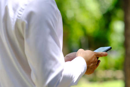 businessman using a smartphone and working on technology concept