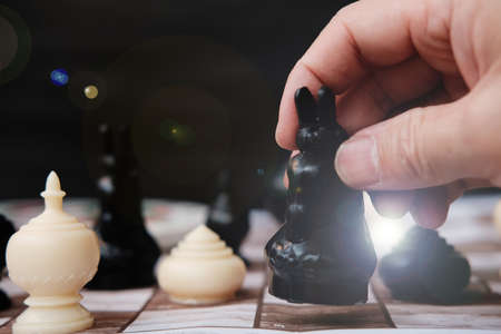 Hand holding chess board, Businessman play with chess game and business growth concept, Creative new idea, Management or leadership concept Фото со стока