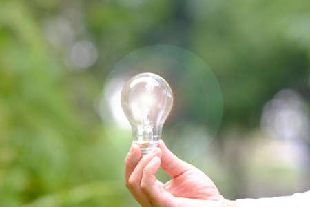 Hand holding energy saving light bulb and business growth concept,Creative new idea