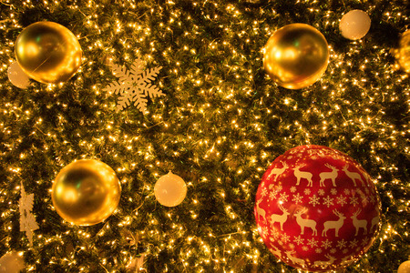 Christmas red and glod ball on the branches fir glowing garland , Christmas or New Years background.