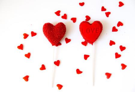 Heart cake pops on white background . Valentine day