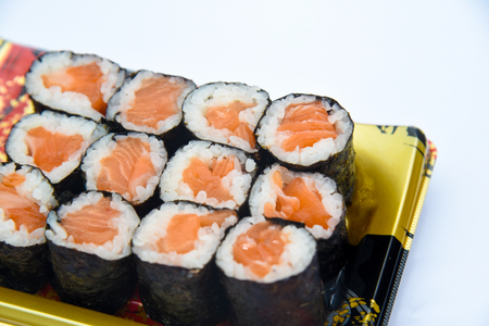 Sushi Roll with salmon on the white background .Food abstract background Reklamní fotografie