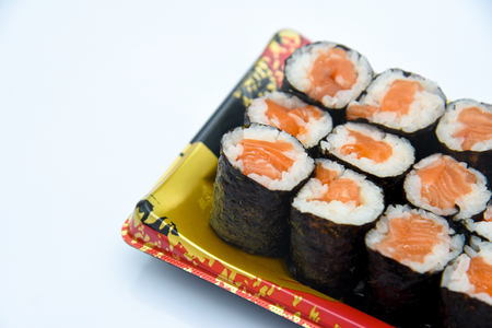Sushi Roll with salmon on the white background .Food abstract background Stockfoto