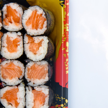 Sushi Roll with salmon on the white background .Food abstract background. Stockfoto