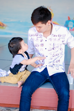 Cute little  Asian boy and father Happy smilling  in the park outdoors , Happy kids