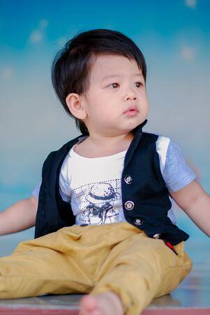 Cute little  Asian boy Happy smilling  in the park outdoors , Happy kids