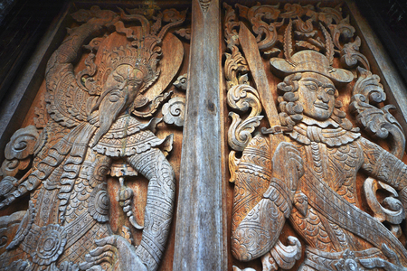 europeans: Temple door carved Asians with Europeans. Stock Photo