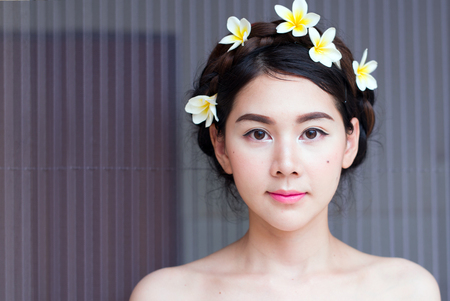 Asian women face beautiful There are many flowers attached to me. Stock Photo
