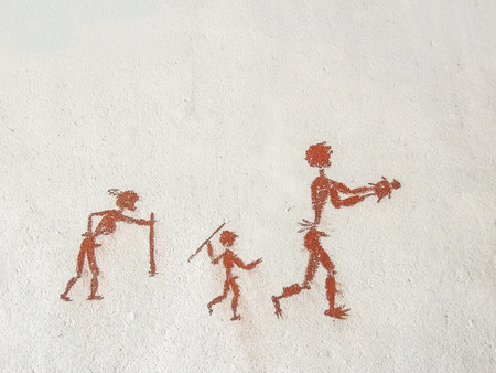 Painting on the wall inside the cave. Primitive Stock Photo