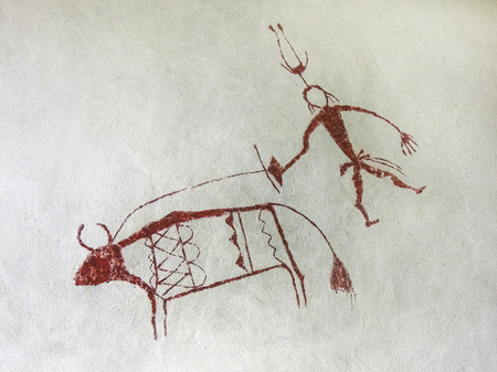 pre: Painting on the wall inside the cave. Primitive Stock Photo