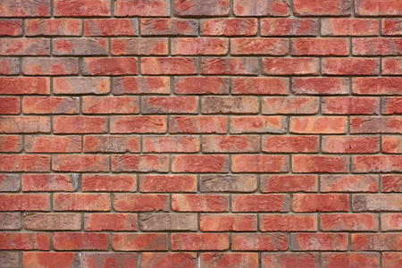 Orange brick wall. The example of brickwork as exterior wall facing. Stock fotó