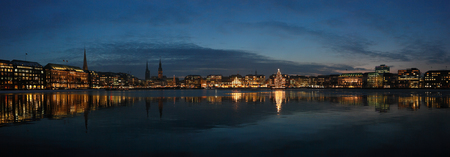 Night cityscape of Hamburg. Panorama of evening lights on the Alster lake of Hamburg, Germany.