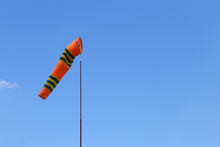 Wind cone against blue sky. Windsock in perfect flying weather.