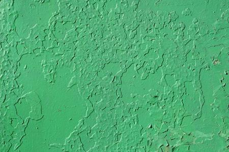 古い壁。緑色の古いぼろぼろ壁のテクスチャ。