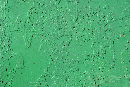Old wall. Texture of the old shabby wall in green.
