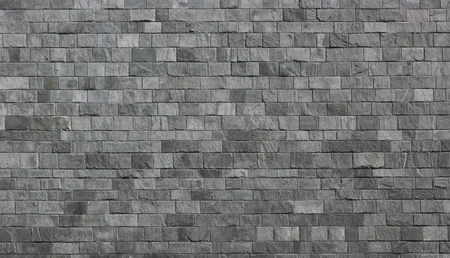 exemplar: Stone wall as a background or texture. An example of masonry as a cladding of external walls.
