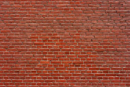 Brick wall. The traditional brickwork made of red bricks. Stock Photo